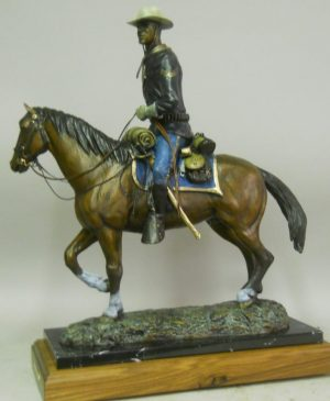 """Buffalo Soldier"" by Gary Kerby Marble and Walnut Base 18'""H X 24"" L"